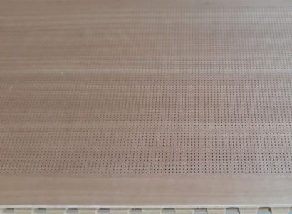 Micropierced Sound Absorbing Boards